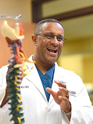Dr Amiel Bethel speaks with patient about spine surgery