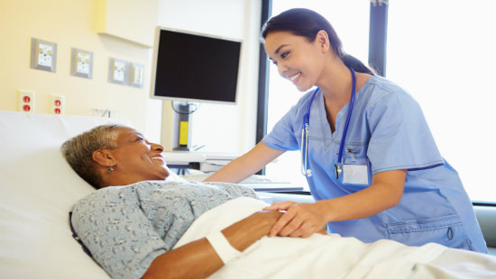 Patient in Hospital Bed Talking with Physician