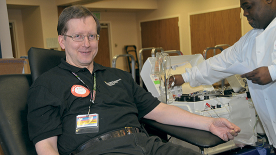 A person donates blood at a University of Maryland Medical Center blood drive