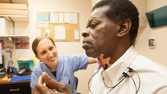 A University of Maryland Medical Center speech pathologist works with a patient